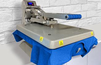 Heat press machine transferring the design on to a t-shirt