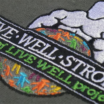 photo of Live Well Strong polo shirt embroidery